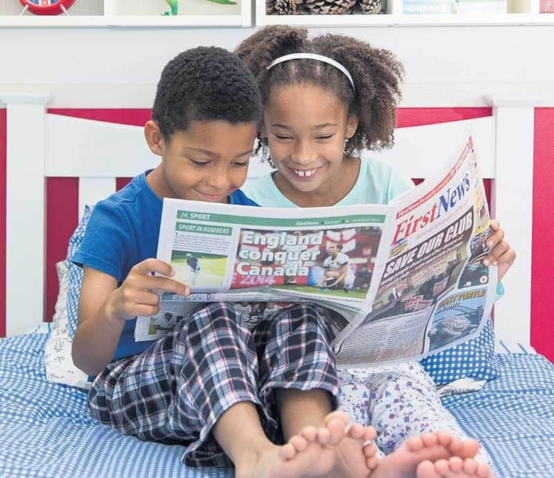 children reading frst news (1)